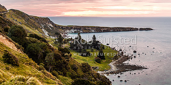 Kinikini Point, with Taramahiti Point (Long Point) behind, on Mahia Peninsula, at dusk. Kinikini Station. Looking south into Hawke Bay. Panorama, Mahia, Wairoa District, Hawke's Bay Region, New Zealand (NZ) stock photo.