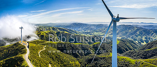Meridian Energy's Project West Wind farm of 62 turbines west of Wellington. Looking north over Terawhiti Station towards Ohariu Valley. Aerial panorama, South Makara, Wellington City District, Wellington Region, New Zealand (NZ) stock photo.