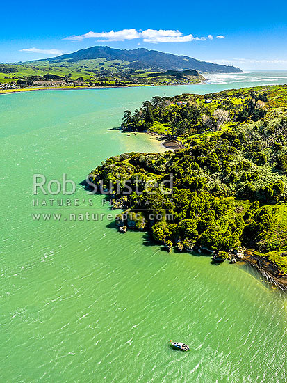 Raglan Harbour and entrance, seen from Marotaka Point Te Akau, across the harbour from Raglan town. Mt Karioi (756m) distant. Aerial view, Raglan, Waikato District, Waikato Region, New Zealand (NZ) stock photo.