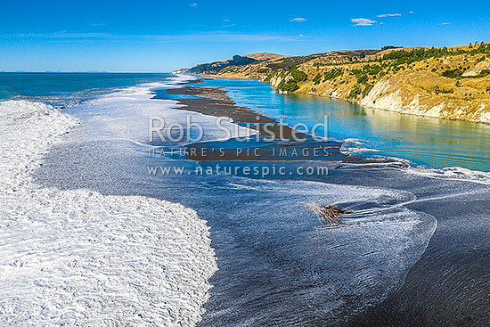 Hurunui River mouth, aerial view looking south over coastal bar awash at high tide. North Canterbury, Hurunui Mouth, Hurunui District, Canterbury Region, New Zealand (NZ) stock photo.