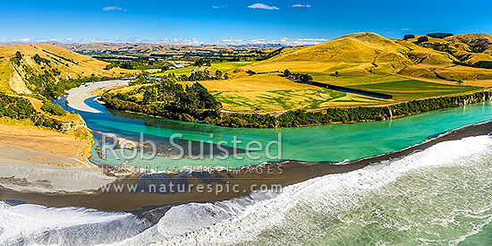 Hurunui River mouth panorama, aerial view looking inland towards Domett and surrounding farmland North Canterbury, Hurunui Mouth, Hurunui District, Canterbury Region, New Zealand (NZ) stock photo.