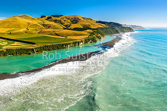 Hurunui River mouth aerial view looking north along bar towards Manuka Bay and Point Gibson. North Canterbury, Hurunui Mouth, Hurunui District, Canterbury Region, New Zealand (NZ) stock photo.