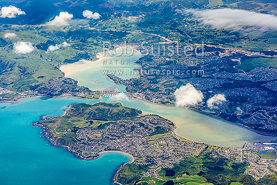 Porirua Harbour entrance, Pauatahanui Arm centre, and Onepoto Arm right. Aerial view over Titahi Bay, Plimmerton, Mana, Paremata and Whitby. Transmission Gully behind, Porirua Harbour, Porirua City District, Wellington Region, New Zealand (NZ) stock photo.