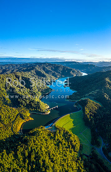 Hunua Ranges, with Wairoa Reservior and water supply collection dam amongst forested ranges. Aerial view, Hunua, Franklin District, Waikato Region, New Zealand (NZ) stock photo.