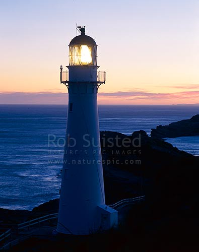 Castlepoint Lighthouse at dusk, Castlepoint, Masterton District, Wellington Region, New Zealand (NZ) stock photo.