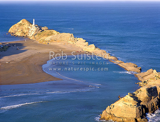 Overlooking Castlepoint Reef, Lagoon & lighthouse from Castle Rock. Last sunlight, Castlepoint, Masterton District, Wellington Region, New Zealand (NZ) stock photo.