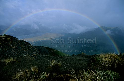 Rainbow over the Waimakariri River., from above the Andrews Stream, Canterbury, Arthur's Pass National Park, Selwyn District, Canterbury Region, New Zealand (NZ) stock photo.