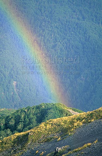 Rainbow over the Andrews Stream, Canterbury, Arthur's Pass National Park, New Zealand (NZ) stock photo.