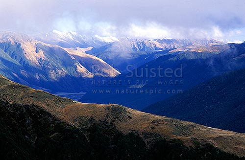 From Travers Peak (above Lewis Pass) down the Lewis Valley. Foleys Creek in foreground, Lewis Pass, Hurunui District, Canterbury Region, New Zealand (NZ) stock photo.