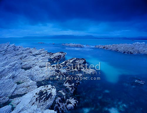 Evening sky over South Bay and sea, Kaikoura, Kaikoura District, Canterbury Region, New Zealand (NZ) stock photo.