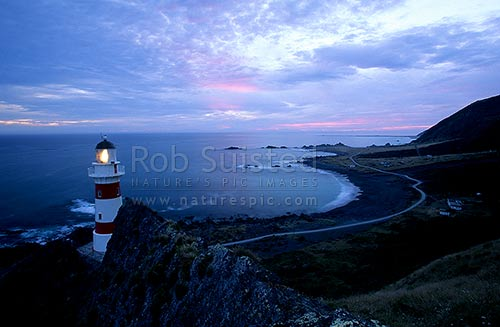 Cape Palliser Lighthouse at dusk, Cape Palliser, South Wairarapa District, Wellington Region, New Zealand (NZ) stock photo.