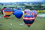 16 hot air balloons ready to rise