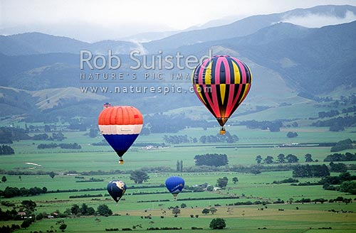 Hot air balloons over the Wairarapa countryside, Carterton, Carterton District, Wellington Region, New Zealand (NZ) stock photo.