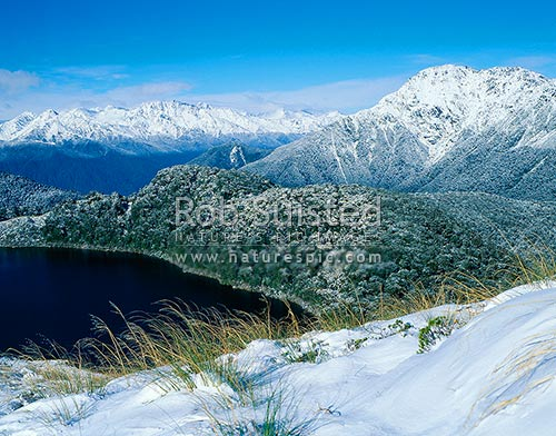 South over Lake Leeb (970m) and Thomson Range to the Arawhata River valley, South Westland, Westland District, West Coast Region, New Zealand (NZ) stock photo.